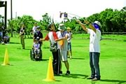 """Photograph : Join the staff of the institution for special needs children of Hachijyo Island, at """"Universal Sports""""."""