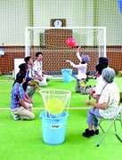 Photograph : They are enjoying original game with sitting on a chair or ground.